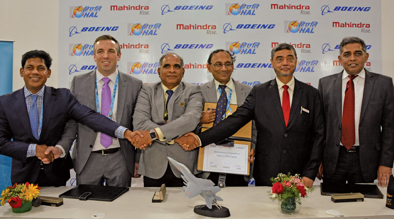 Boeing signs an agreement with HAL and Mahindra Defence for F/A-18. In the picture, Boeing's Pratyush Kumar (left) with HAL CMD Suvarna Raju (3rd from left) and Mahindra Defence's S.P. Shukla (2nd from right). For detailed report, look out for the May issue