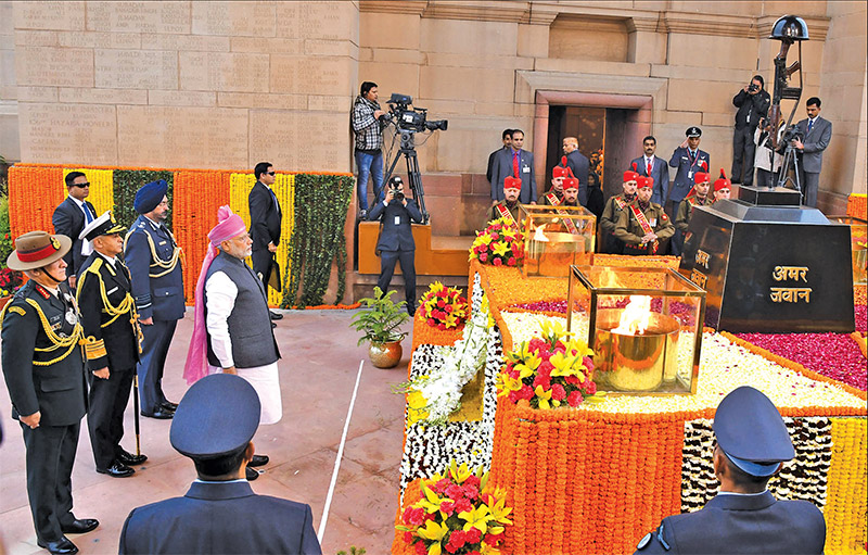 Prime Minister Narendra Modi with the three Service Chiefs at the Amar Jawan Jyoti