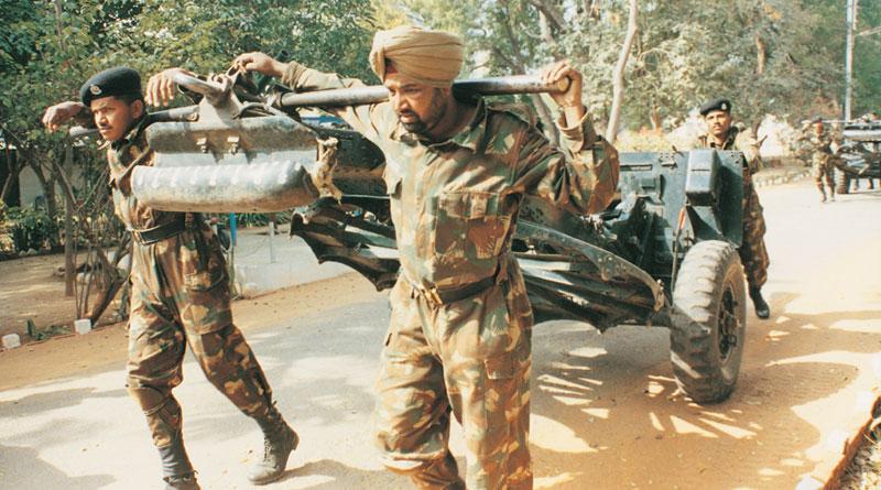 BSF men pulling World War II 25-pounder gun
