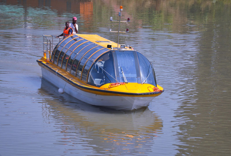 A luxury bus boat during a trial run on the River Jhelum hot of the Srinagar City